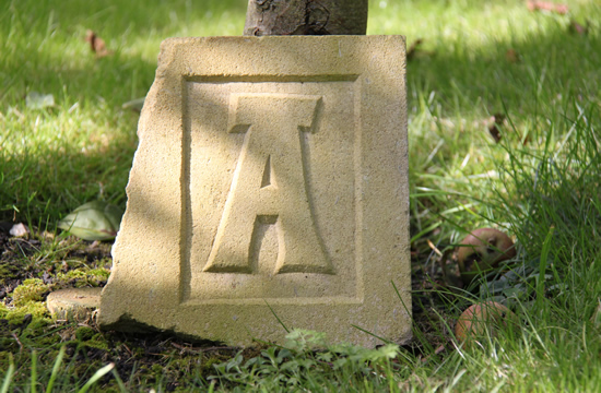 Raised letter in sandstone