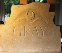 The first memorial sealing stone - lime stone, relief cut symbols and v-cut lettering